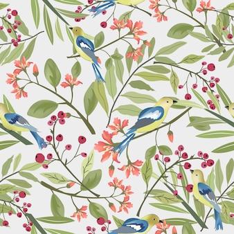 美しい鳥と緑の葉のシームレスなパターンを持つ花。