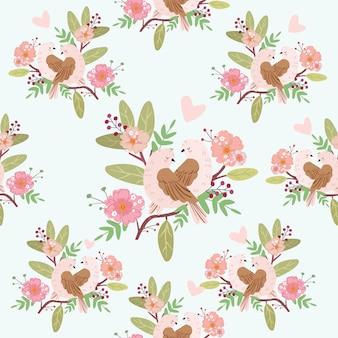 シームレスな花柄のかわいいカップル鳥。