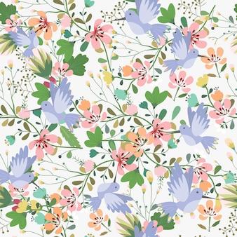 シームレスパターンの甘い花と青い鳥。