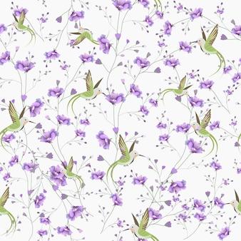 美しい紫色の花とハチドリのシームレスパターン。