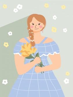 かわいい女の子が立って花束を保持します。