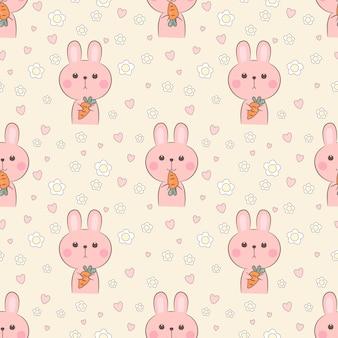 シームレスパターンかわいいウサギはニンジンを保持します。