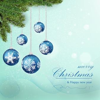 青い背景にぶら下がっているクリスマスボール