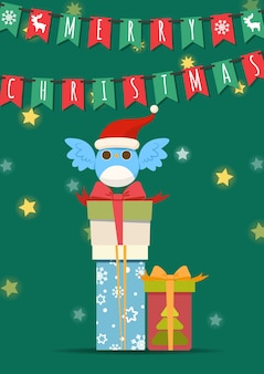 ギフトボックスの山に青い鳥のメリークリスマス。