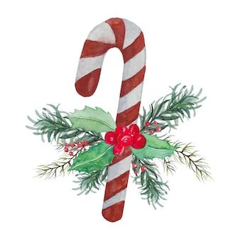 Рождественская конфета с зелеными и красными листьями и красной ягодой - украшение рождественского праздника