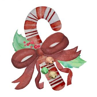 緑と赤の葉とリボンの弓-クリスマスのお祝いの装飾と小さな鐘とクリスマスキャンディ