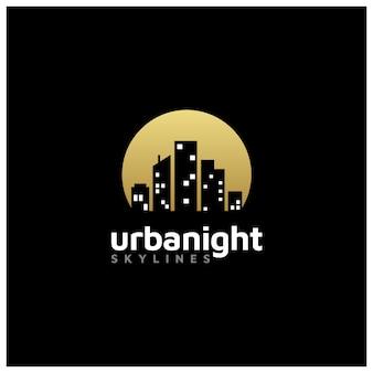 不動産ロゴのための夜の街のスカイライン