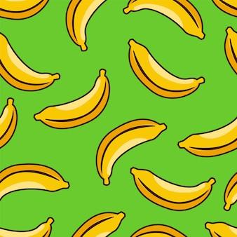 緑の背景と黄色のバナナのシームレスパターン