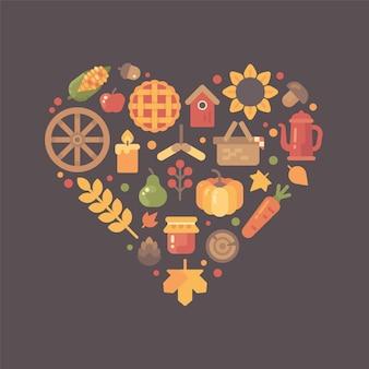 フラットな秋のアイコンが心臓の形に配列カラフルな秋のアイテムセット