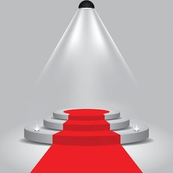 Красная дорожка к подиумной сцене с прожектором