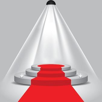 Красная дорожка к подиумной сцене с прожекторами