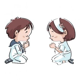 聖体拝領で祈る子供たち