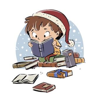 Мальчик читает книги на рождество