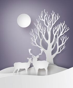雪のフィールドで一緒に立っている鹿カップル