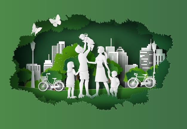 Концепция эко и окружающей среды с счастливой семьей