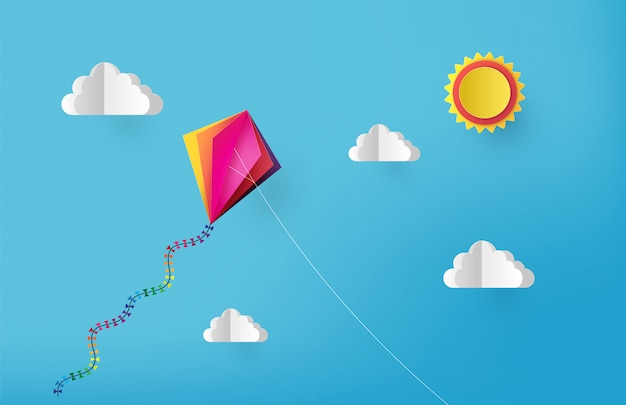 カラフルな凧が空を飛んでいます。紙のカットスタイル。