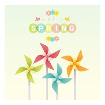 こんにちは春の背景にカラフルな風車