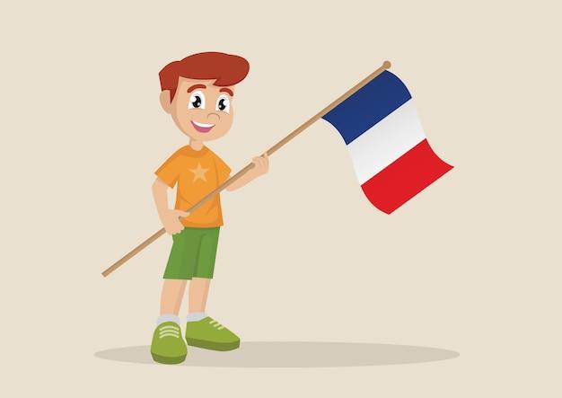 フランスの旗を掲げている少年。