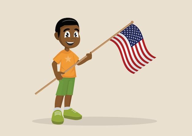 アメリカの旗を掲げているアフリカの男の子。