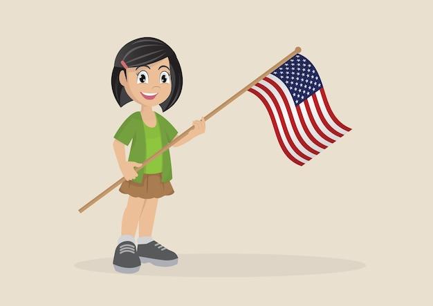 アメリカの旗を持っている少女。
