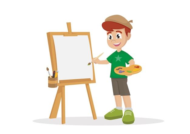 キャンバスに絵を描くアーティストの少年。