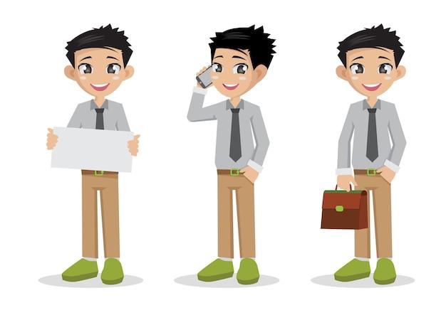 携帯電話を持っている若い男のビジネスマン