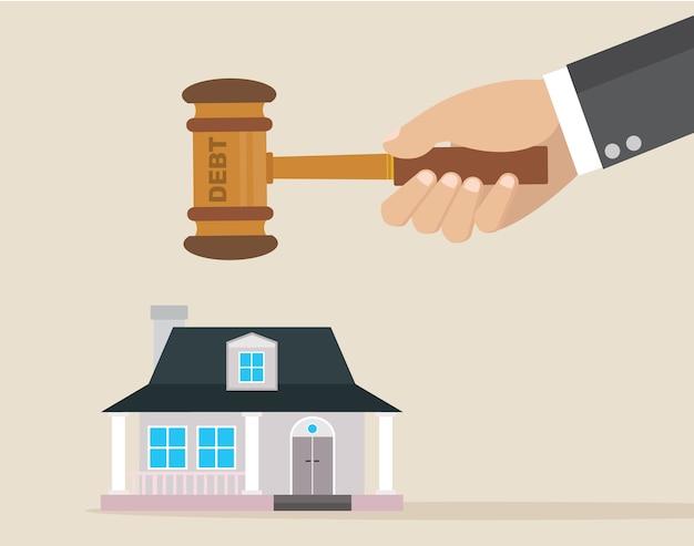 ビジネスマンは家を破壊するために借金のハンマーを扱う。