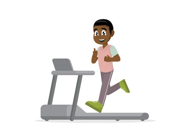 アフリカの男はトレッドミルで走っています。