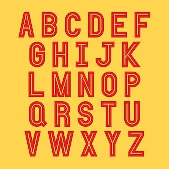 黄色の背景に赤のアルファベット文字