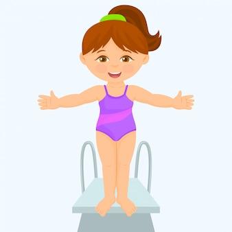 若い女の子がダイビングボードに立っています。