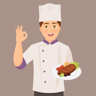 Шеф-повар держит блюдо, давая идеальный знак