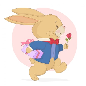 Кролик бежит с подарочной коробкой и розой