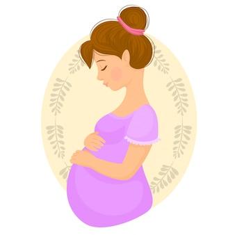 彼女の赤ちゃんのバンプを保持している保護母親