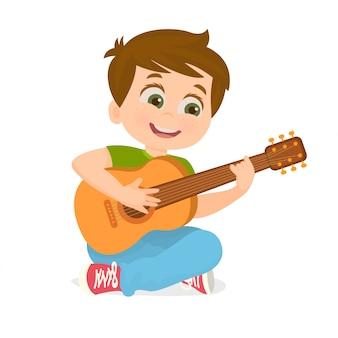 Мальчик играет на гитаре