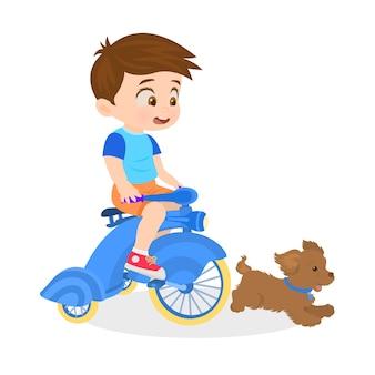 Мальчик на велосипеде со своей собакой
