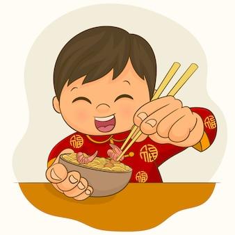 中国の少年が食事を食べる