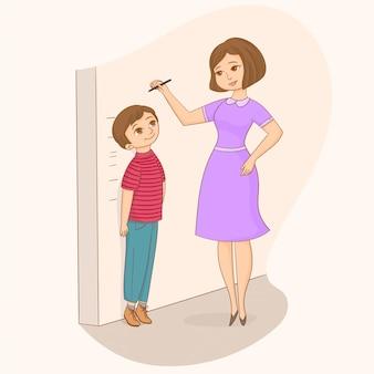 母は彼女の息子の壁の高さを測定