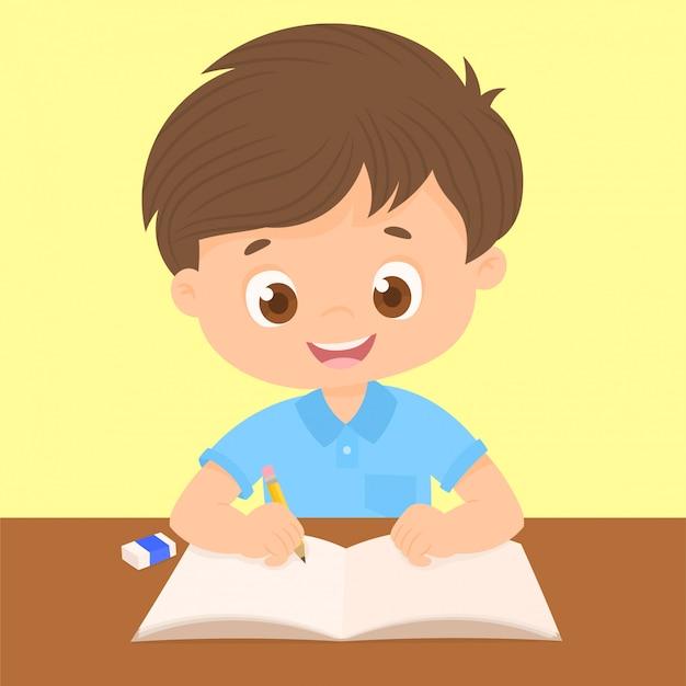彼の机で書いている少年