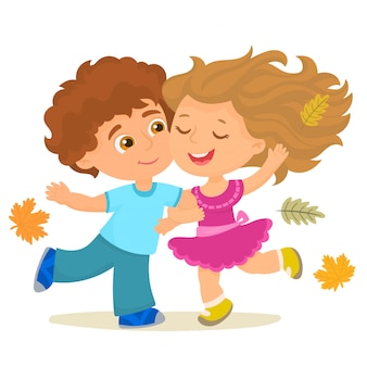 Мальчик и девочка счастливы в осенний день