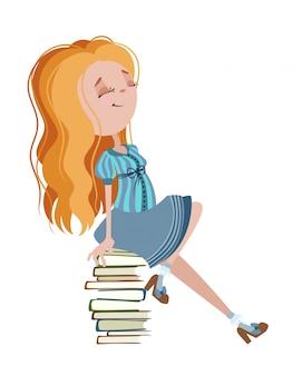 女の子は本に座っている。