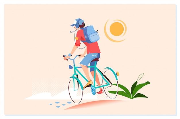 幸せな若い男は外自転車に乗っています。