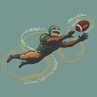 ボールをキャッチするアメリカンフットボール選手