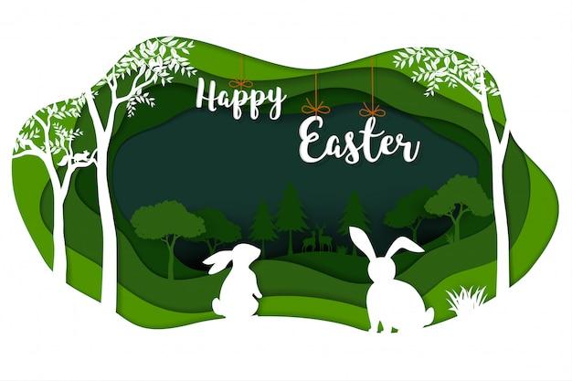 緑の自然に白いウサギとハッピーイースター