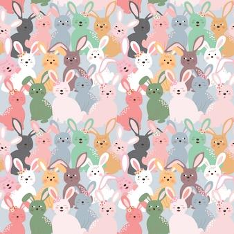 パステル調の青い背景にかわいいカラフルなウサギのシームレスパターン