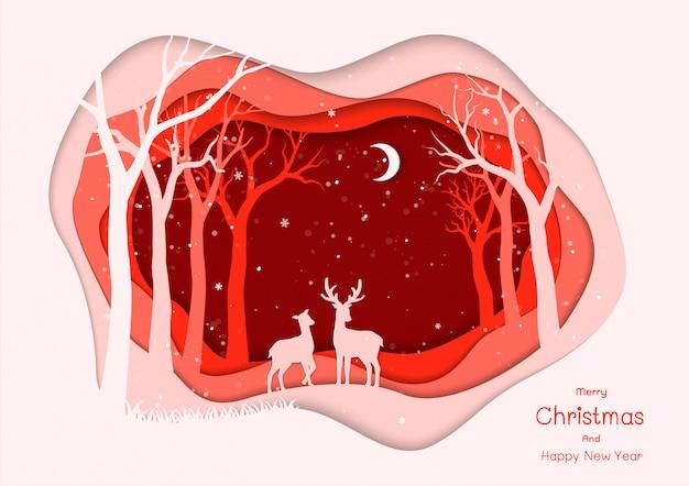メリークリスマスと新年あけましておめでとうございます冬の赤い夜の図に鹿家族と