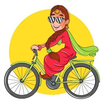 サングラスをかけて、自転車に乗る女。