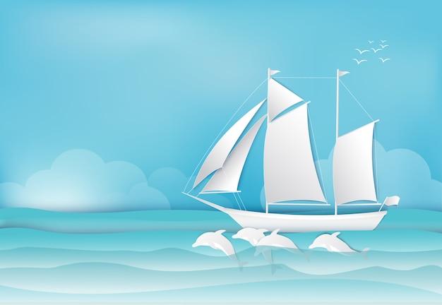 帆船と海の背景のイルカ