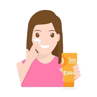 女性の顔に日焼け止めを適用する