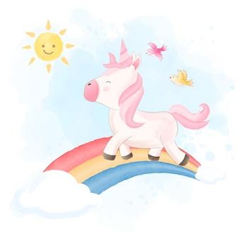 かわいいユニコーンと虹の手描きイラスト