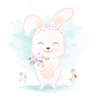 かわいいウサギの花束を保持